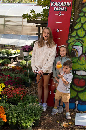 09/30/19 Wesley Bunnell | StaffrrMadelyn Rogers, age 11, Emily Rogers, age 8, and Hudson Rogers, age 3, pose for a photos for their mother during a family trip at Karabin Farms in Southington on Monday afternoon.