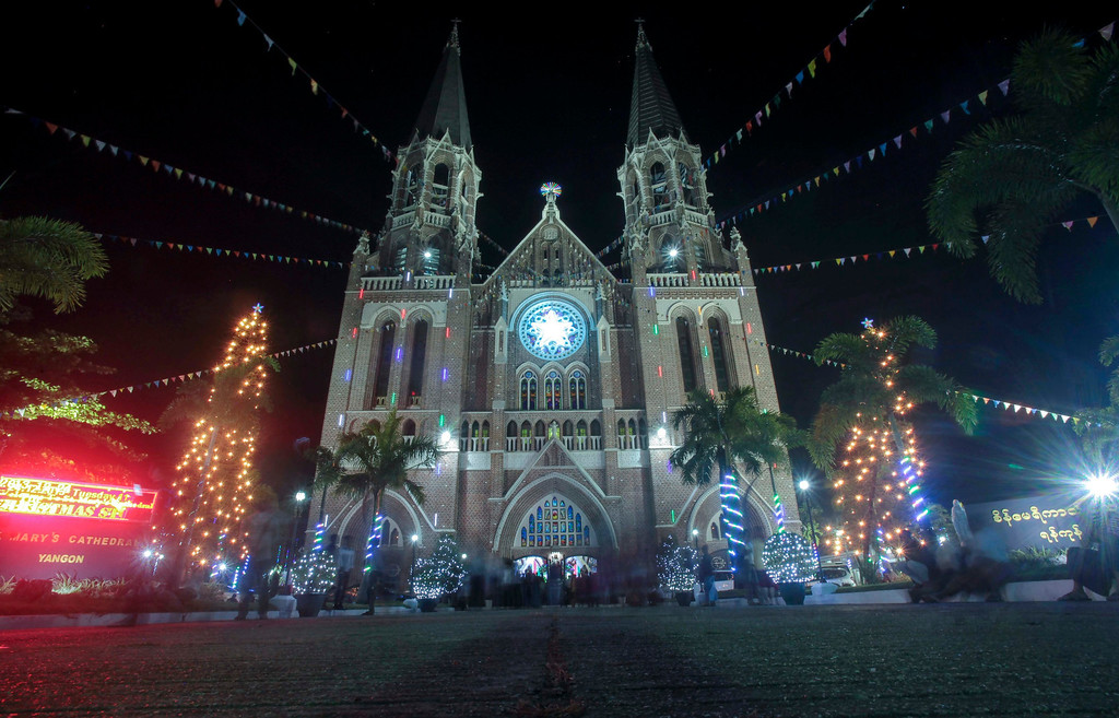 . People walks around the compound of St. Mary\'s Cathedral as they participate in the christmas eve ceremony in Yangon, Myanmar, 24 December 2013.  EPA/LYNN BO BO