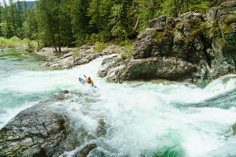 Christian Woodard flying through the rapid next to Thor's Hammer on the Little North Santiam River in Oregon.