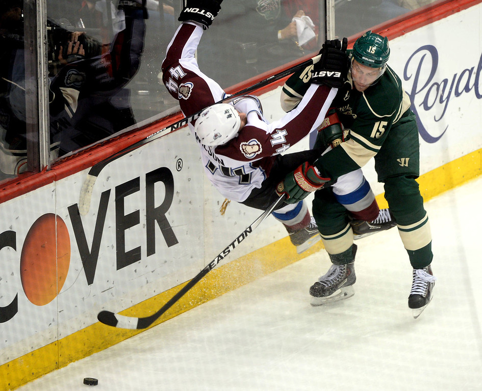 . Minnesota Wild left wing Dany Heatley checks Colorado Avalanche defenseman Ryan Wilson into the boards and takes the puck during the second period.  (Pioneer Press: Sherri LaRose-Chiglo)