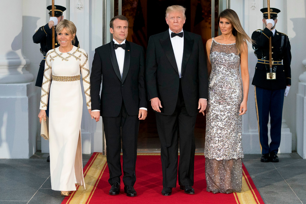 . President Donald Trump, first lady Melania Trump, French President Emmanuel Macron and his wife Brigitte Macron, pose for photographs as they arrive for a State Dinner at the White House in Washington, Tuesday, April 24, 2018. (AP Photo/Andrew Harnik)