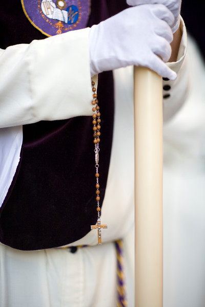 Penitent bearing a candle and a rosary, Holy Week, Seville, Spain
