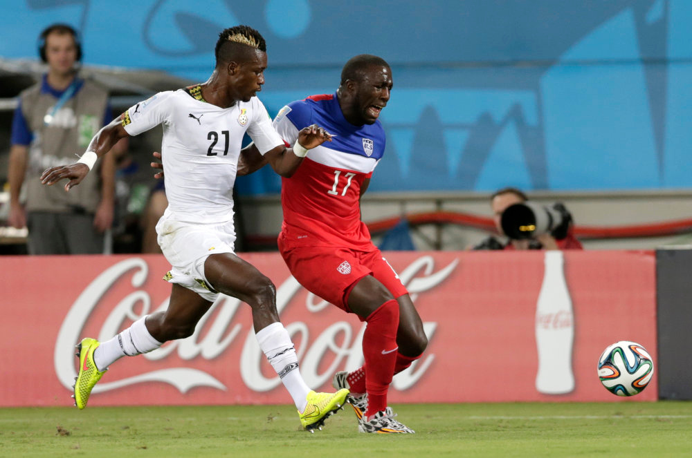 Description of . United States' Jozy Altidore, right, shouts out as he pulls up injured as Ghana's John Boye looks on during the group G World Cup soccer match between Ghana and the United States at the Arena das Dunas in Natal, Brazil, Monday, June 16, 2014. (AP Photo/Dolores Ochoa)