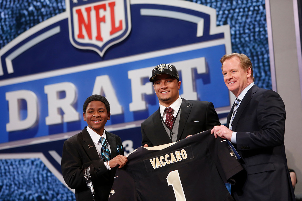. Kenny Vaccaro, from Texas, stands with NFL Commissioner Roger Goodell, right, and Markell Gregoire, 13, a patient at St. Jude Children\'s Research Hospital, after being selected 15th overall by the New Orleans Saints in the first round of the NFL football draft, Thursday, April 25, 2013, at Radio City Music Hall in New York. (AP Photo/Jason DeCrow)