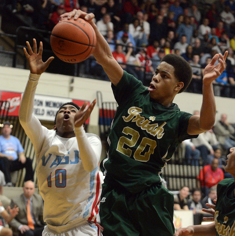 . Duncan Scott/DScott@News-Herald.com Ursuline\'s Dave Collins grabs a rebound from VASJ\'s Maurice Johnson in the third quarter. VASJ defeated Youngstown Ursuline 69-60 March 15 in the Division III regional final at Canton Memorial Fieldhouse.
