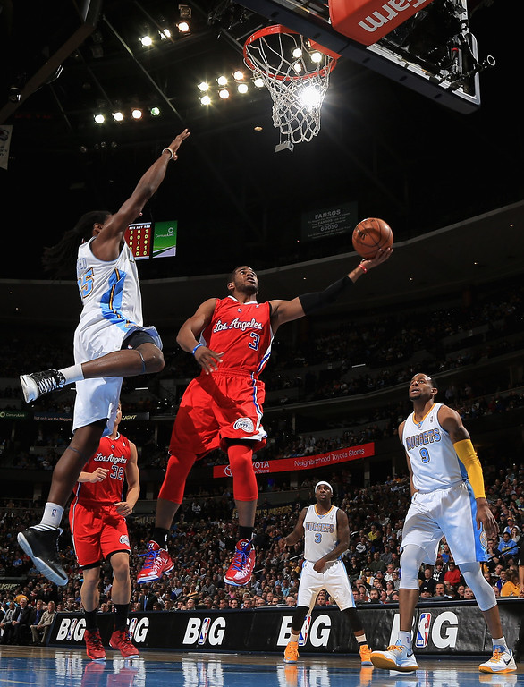 . DENVER, CO - MARCH 07:  Chris Paul #3 of the Los Angeles Clippers lays up a shot only to have it blocked by Kenneth Faried #35 of the Denver Nuggets at the Pepsi Center on March 7, 2013 in Denver, Colorado.  (Photo by Doug Pensinger/Getty Images)