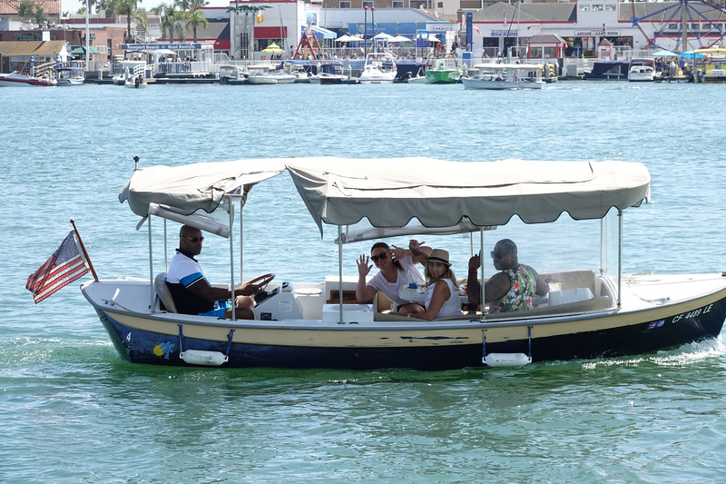 """A """"Duffy"""" boat out for a ride on Balboa Island."""