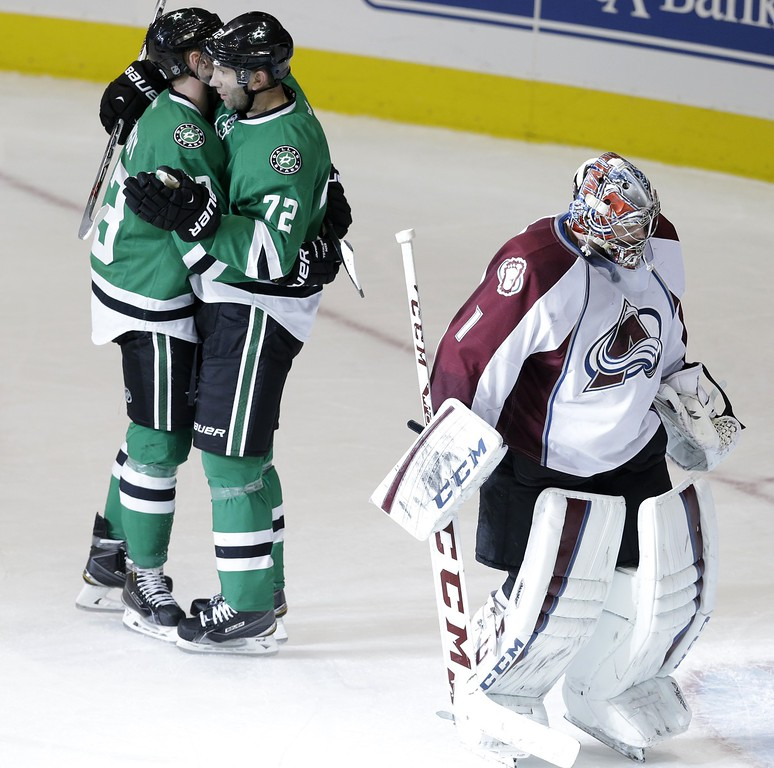 . Colorado Avalanche goalie Semyon Varlamov (1) skates away as Dallas Stars right wing Erik Cole (72) celebrates scoring a goal with teammate Ales Hemsky (83) during the second period of an NHL hockey game Tuesday, Feb. 3, 2015, in Dallas. (AP Photo/LM Otero)