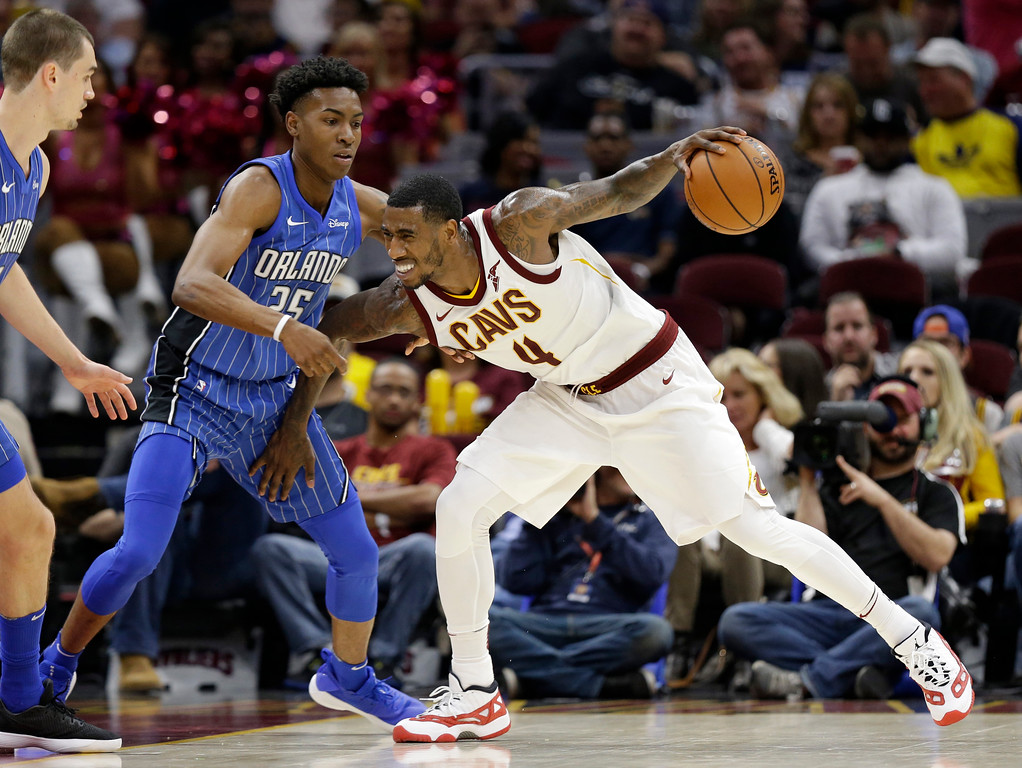 . Cleveland Cavaliers\' Iman Shumpert (4) drives past Orlando Magic\'s Wesley Iwundu (25) in the second half of an NBA basketball game, Saturday, Oct. 21, 2017, in Cleveland. (AP Photo/Tony Dejak)