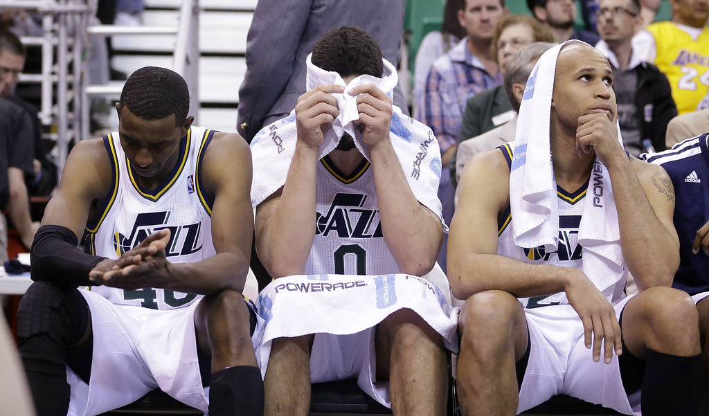 . Utah Jazz\'s Jeremy Evans, left, Enes Kanter, center, and Richard Jefferson, right, sit on the bench in the final minute of the fourth quarter during an NBA basketball game against the Los Angeles Lakers Monday, April 14, 2014, in Salt Lake City, Utah. The Lakers won 119-104. (AP Photo/Rick Bowmer)