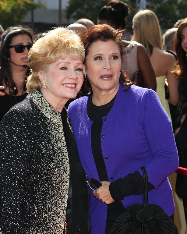 ". Debbie Reynolds (L) and Carrie Fisher attends the 2011 Primetime Creative Arts Emmy Awards at Nokia Theatre on September 10, 2011 in Los Angeles, California.  Reynolds was honored with the Life Achievement Award. Reynolds, star of the 1952 classic ""Singin\' in the Rain\"" died Wednesday, Dec. 28, 2016. She was 84. Her daughter, Fisher, died Dec. 27, 2016. (Photo by Noel Vasquez/Getty Images)"