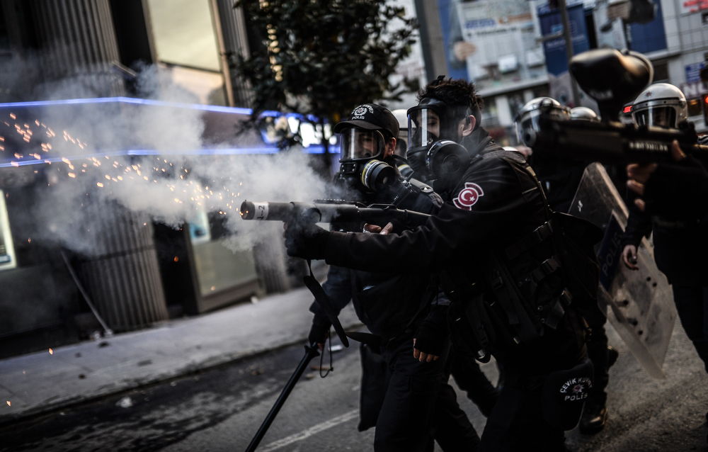 . Police use tear gas after the funeral of Berkin Elvan, the 15-year-old boy who died from injuries suffered during last year\'s anti-government protests, in Istanbul on March 12, 2014. Riot police fired tear gas and water cannon at protestors in the capital Ankara, while in Istanbul, crowds shouting anti-government slogans lit a huge fire as they made their way to a cemetery for the burial of Berkin Elvan. (BULENT KILIC/AFP/Getty Images)