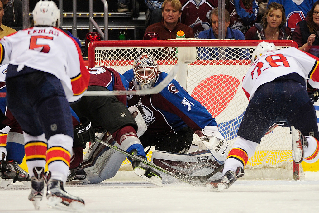 . DENVER, CO - MARCH 3: Colorado Avalanche goalie Calvin Pickard (31) watches the puck as left wing Garrett Wilson (28) and Florida Panthers defenseman Aaron Ekblad (5) make their way towards the goal during the third period at the Pepsi Center on March 3, 2016 in Denver, Colorado. The Colorado Avalanche defeated the Florida Panthers 3-2. (Photo by Brent Lewis/The Denver Post)
