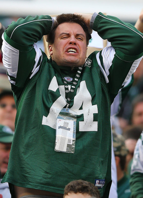 . A New York Jets fan reacts after an incompletion by  Mark Sanchez #6 of the New York Jets during their game against the Arizona Cardinals at at MetLife Stadium on December 2, 2012 in East Rutherford, New Jersey.  (Photo by Al Bello/Getty Images)