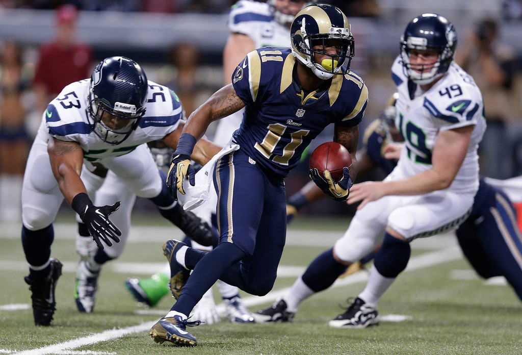 . St. Louis Rams wide receiver Tavon Austin (11) runs on a punt return against Seattle Seahawks outside linebacker Malcolm Smith (53) during the first half of an NFL football game, Monday, Oct. 28, 2013, in St. Louis. (AP Photo/Michael Conroy)