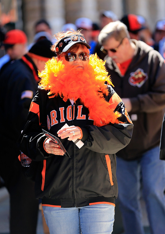 . Fans enter the stadium before the start of the Baltimore Orioles and Boston Red Sox Opening Day game at Oriole Park at Camden Yards on March 31, 2014 in Baltimore, Maryland.  (Photo by Rob Carr/Getty Images)