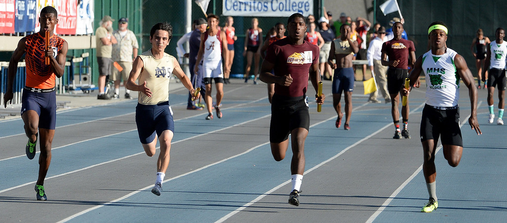 . Chaminade\'s TJ Brock, left, Notre Dame\'s Koa Farmer, Highland\'s Victor Rivera and Monrovia\'s Cravon Gillespie runs the last leg of the 4x100 meter race during the CIF-SS Masters Track and Field meet at Falcon Field on the campus of Cerritos College in Norwalk, Calif., on Friday, May 30, 2014.   (Keith Birmingham/Pasadena Star-News)