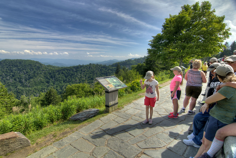 Families and friends enjoy the view from the Newfound Gap Overlook near the very top of the Great Smoky Mountains National Park in Cherokee, NC on Sunday, August 4, 2013. Copyright 2013 Jason Barnette