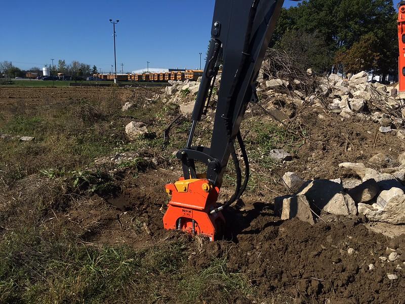 NPK C2D plate compactor on Deere 50G mini excavator - trenching - Murphy Tractor 2017 (1).JPG