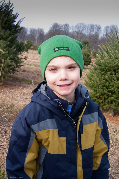 K.C. has a good time picking out Christmas trees.