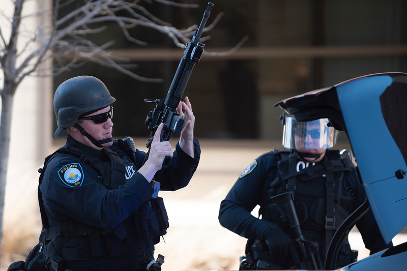 Police officers prepare to respond to a swatting call on Northwestern University's campus on Wednesday, March 14, 2018 in Evanston, Ill. | Colin Boyle/The Daily Northwestern
