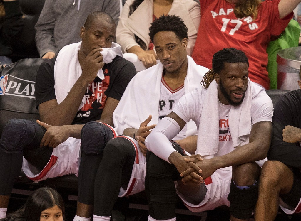 . Toronto Raptors\' Serge Ibaka, left, DeMar DeRozan and DeMarre Carroll watch the action from the bench as they take on the Cleveland Cavaliers during the second half of Game 3 of an NBA basketball second-round playoff series in Toronto on Friday, May 5, 2017. (Fred Thornhill/The Canadian Press via AP)