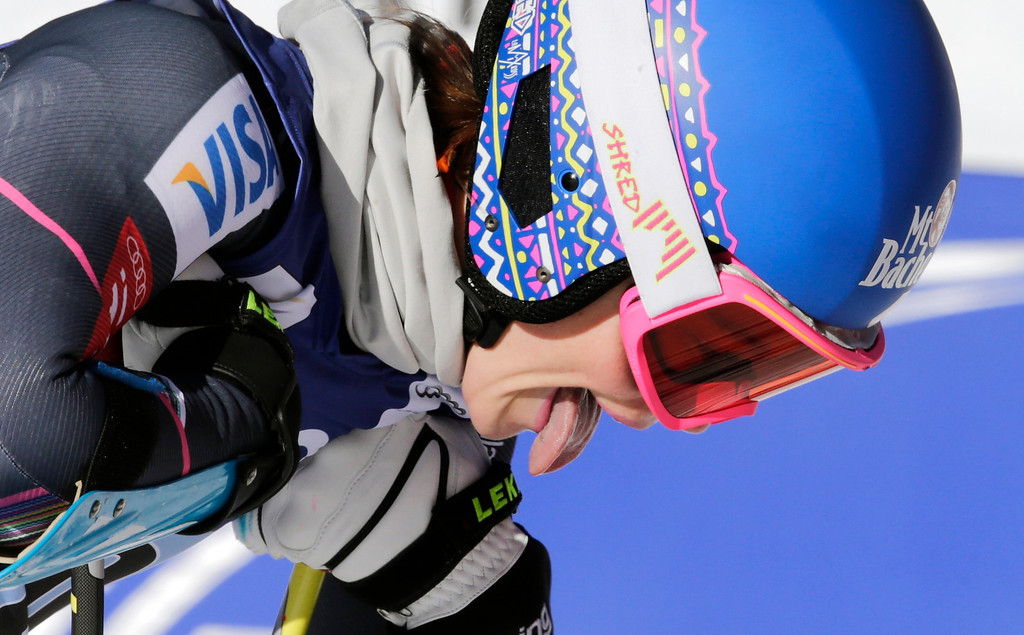 . Laurenne Ross sticks out her tongue as she catches her breath after her run in the women\'s World Cup super-G skiing event, in Beaver Creek, Colo., Saturday, Nov. 30, 2013. (AP Photo/Charles Krupa)