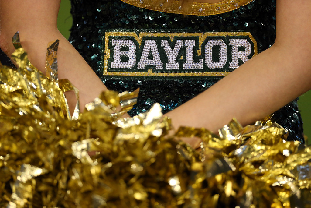 . A Baylor Bears cheerleader stands during the Tostitos Fiesta Bowl against the UCF Knights at University of Phoenix Stadium on January 1, 2014 in Glendale, Arizona.  (Photo by Ronald Martinez/Getty Images)