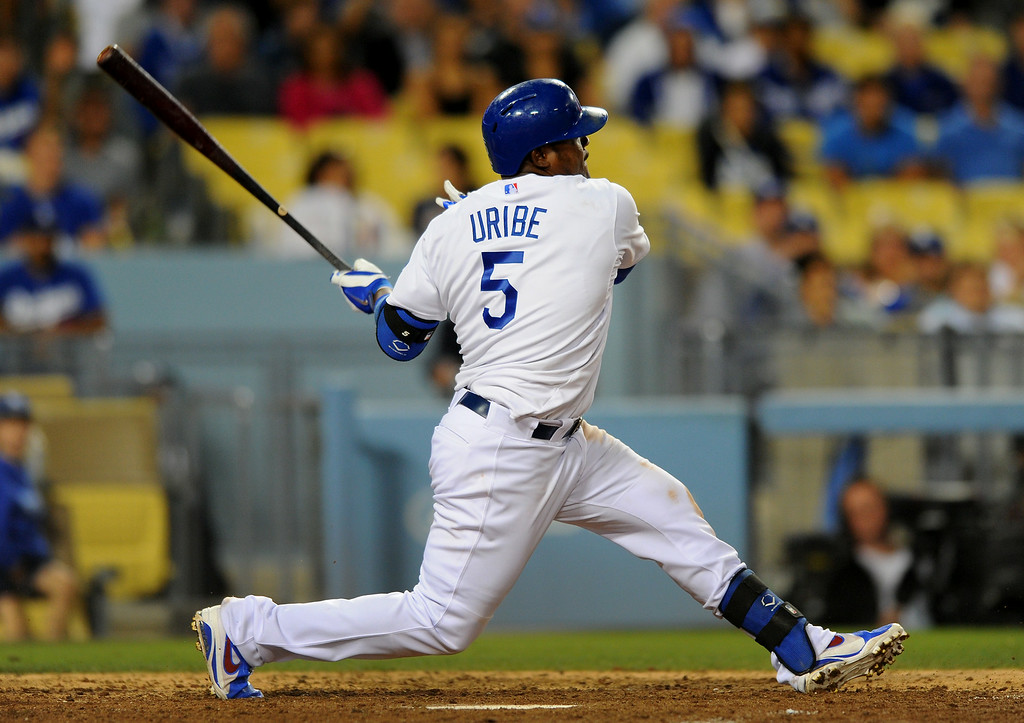 . The Dodgers\' Juan Uribe strikes out in the eighth inning, Friday, July 11, 2014, at Dodger Stadium. (Photo by Michael Owen Baker/Los Angeles Daily News)