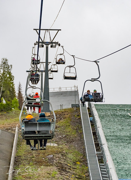 Riding the ski jump lift, in the rain