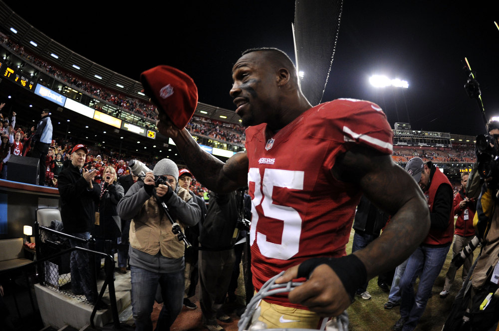 . Tight end Vernon Davis #85 of the San Francisco 49ers celebrates after the NFC Divisional Playoff Game at Candlestick Park on January 12, 2013 in San Francisco, California. The San Francisco 49ers defeated the Green Bay Packers 45 to 31.  (Photo by Harry How/Getty Images)