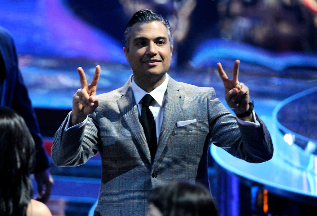. Jaime Camil gestures in the audience at the 15th annual Latin Grammy Awards at the MGM Grand Garden Arena on Thursday, Nov. 20, 2014, in Las Vegas. (Photo by Chris Pizzello/Invision/AP)