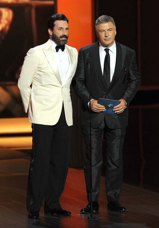 . Actors Jon Hamm and Alec Baldwin speak onstage during the 65th Annual Primetime Emmy Awards held at Nokia Theatre L.A. Live on September 22, 2013 in Los Angeles, California.  (Photo by Kevin Winter/Getty Images)