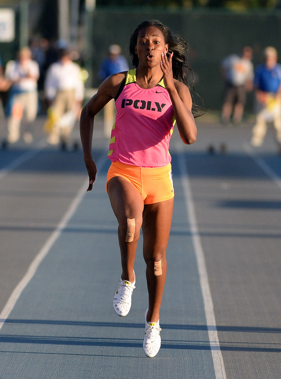 . Long Beach Poly\'s Arianna Washington, center, center wins the 100 meter dash during the CIF-SS Masters Track and Field meet at Falcon Field on the campus of Cerritos College in Norwalk, Calif., on Friday, May 30, 2014.   (Keith Birmingham/Pasadena Star-News)