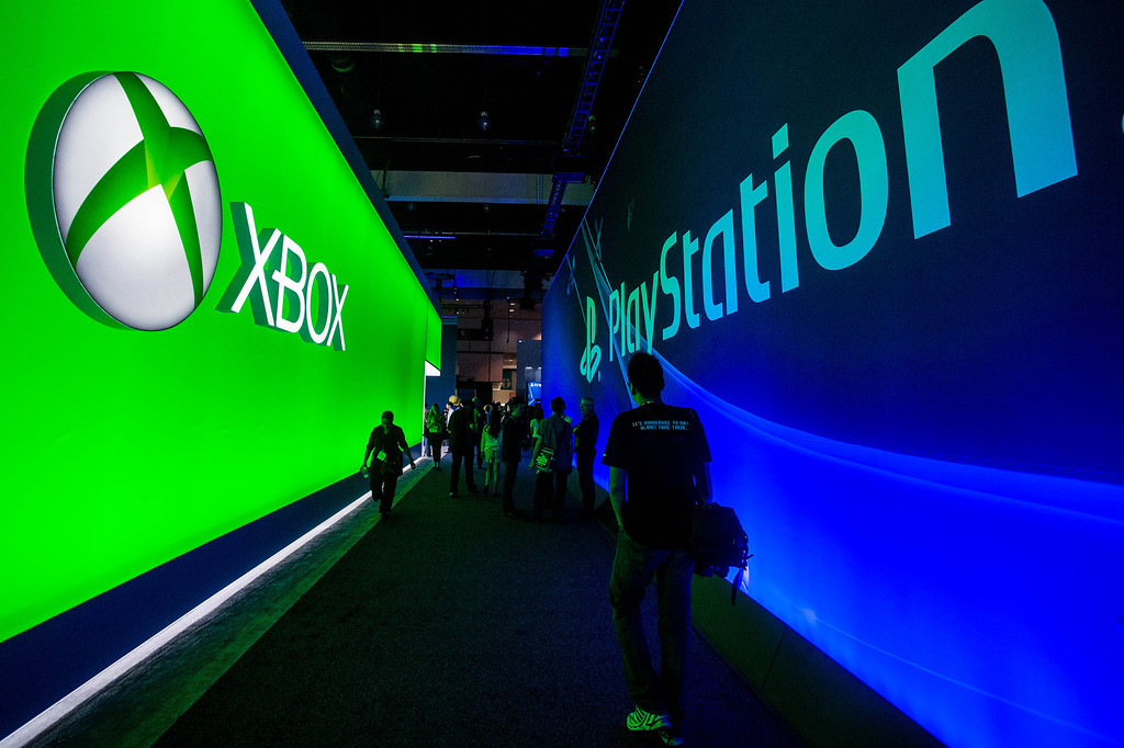 . Attendees walk in an aisle between the Microsoft booth and the Sony booth at theElectronic Entertainment Expo in Los Angeles on Tuesday, June 10, 2014. (Photo by Watchara Phomicinda)
