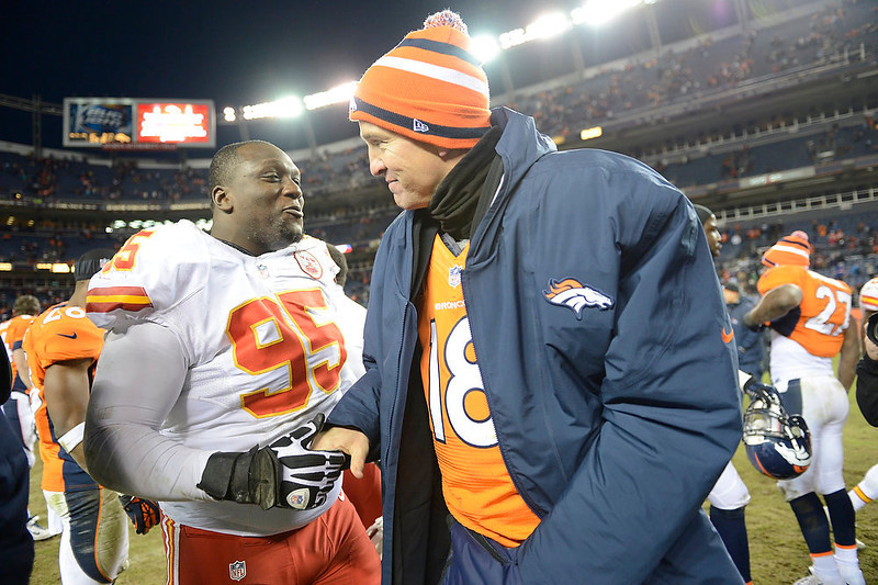 . Denver Broncos quarterback Peyton Manning (18) shakes hands with Kansas City Chiefs nose tackle Jerrell Powe (95) at the end of the game as the Denver Broncos took on the Kansas City Chiefs at Sports Authority Field at Mile High in Denver, Colorado on December 30, 2012. Joe Amon, The Denver Post