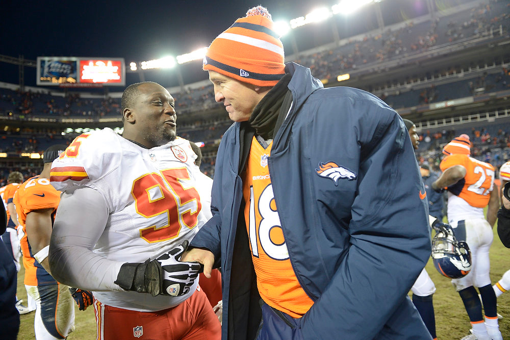 Description of . Denver Broncos quarterback Peyton Manning (18) shakes hands with Kansas City Chiefs nose tackle Jerrell Powe (95) at the end of the game as the Denver Broncos took on the Kansas City Chiefs at Sports Authority Field at Mile High in Denver, Colorado on December 30, 2012. Joe Amon, The Denver Post