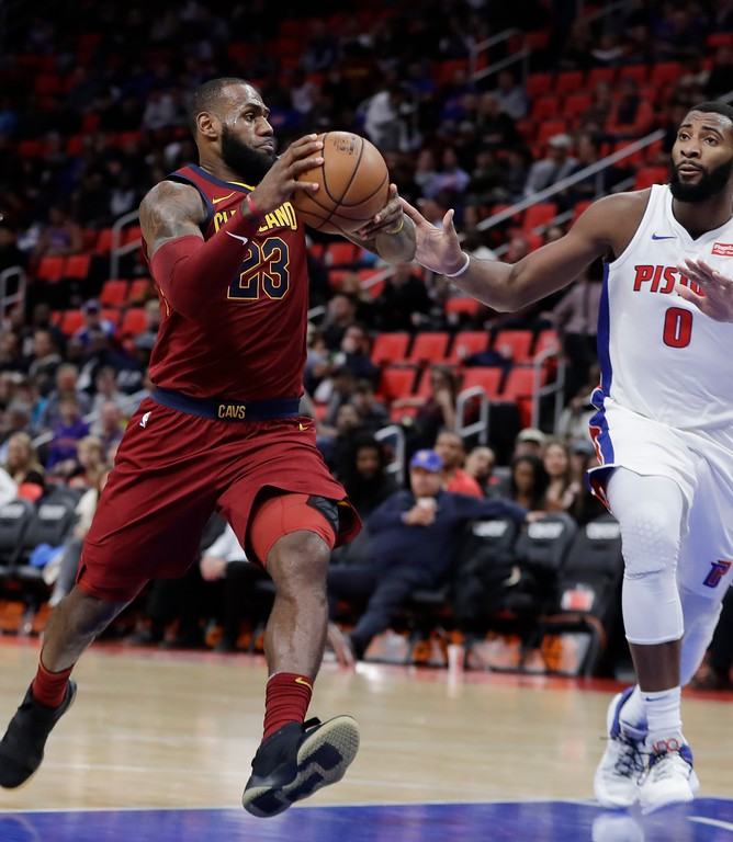 . Cleveland Cavaliers forward LeBron James (23) drives against Detroit Pistons center Andre Drummond (0) during the second half of an NBA basketball game, Monday, Nov. 20, 2017, in Detroit. (AP Photo/Carlos Osorio)