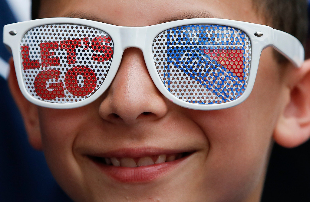 . Alex Selvin, 9, waits outside Madison Sqaure Garden before Game 3 of the NHL hockey Stanley Cup Final between the Los Angeles Kings and New York Rangers, Monday, June 9, 2014, in New York. (AP Photo/Kathy Willens)