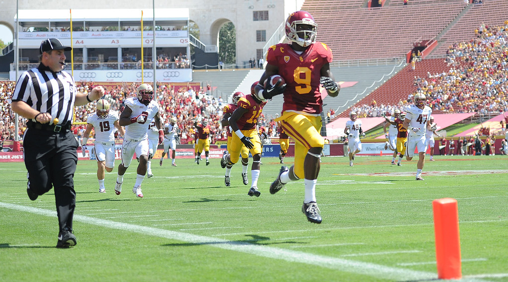 . Southern California wide receiver Marqise Lee (9) catches a pass and runs for a 80 touchdown against Boston College during the first half of an NCAA college football game in the Los Angeles Memorial Coliseum in Los Angeles, on Saturday, Sept. 14, 2013.