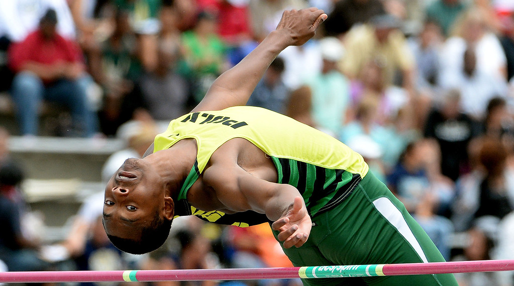 . Long Beach Poly\'s Vincent Calhoun competes in the division 1 high jump during the CIF Southern Section track and final Championships at Cerritos College in Norwalk, Calif., Saturday, May 24, 2014.   (Keith Birmingham/Pasadena Star-News)