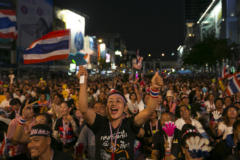 . Anti-government  protestors cheer during the first day of a mass demonstration at a downtown intersection on January 13, 2014 in Bangkok, Thailand. Fear of more violence and instability as the anti-government protesters move forward in an attempt to shutdown Bangkok by blocking major intersections in the heart of the city in their long running campaign to oust the government of Prime Minister Yingluck Shinawatra. Thailand\'s political crisis has continued for months with elections going ahead on February 2nd. ( Photo by Paula Bronstein/Getty Images)
