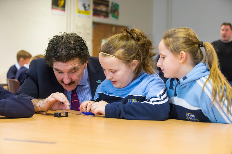 "06/03/2017. FREE TO USE IMAGE. Engineers Week at WIT (Waterford Institute of Technology). Pictured during ""BrushBots Workshop"" are Minister of State John Halligan with Ella Malone and Chloe Walsh pupils from Scoil Mholainge, Listerlin, Co. Kilkenny. Picture: Patrick Browne"