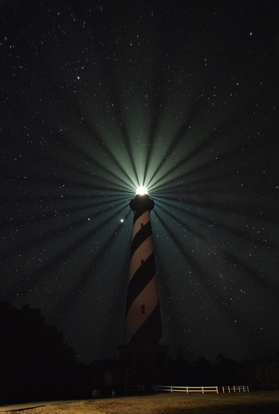 The long still day is ending<br /> In hollow and on height, <br /> The lighthouse seaward sending <br /> White rays of steady light;  - Roderic Quinn<br /> <br /> Hatteras Lighthouse's (stacked) beams of light - Cape Hatteras National Seashore, North Carolina