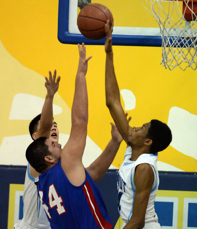 . Walnut\'s Richard Rycraw (C) (44) blocks the shot of Los Altos\' Jayson Jones (44) in the first half of a prep basketball game at Walnut High School in Walnut, Calif., on Wednesday, Jan. 22, 2014. (Keith Birmingham Pasadena Star-News)