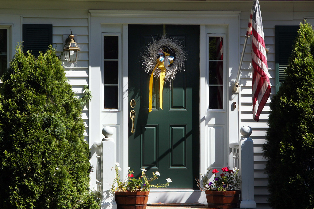 . A ribbon is seen on the front door of the family home of freelance journalist James Foley, Wednesday, Aug. 20, 2014 in Rochester, N.H. Foley was abducted in November 2012 while covering the Syrian conflict. On Tuesday, Aug. 19, militants with the Islamic State extremist group released a video showing Islamic State militants beheading Foley in an act of revenge for U.S. airstrikes in northern Iraq . (AP Photo/Jim Cole)