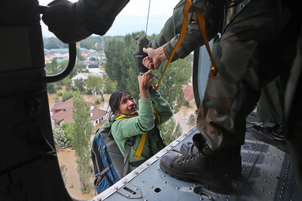 . A woman cries as she is airlifted into a chopper in Srinagar, India, Tuesday, Sept. 9, 2014.  (AP Photo/Dar Yasin)