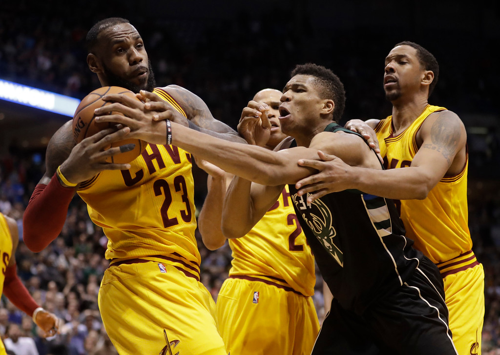 . Milwaukee Bucks\' Giannis Antetokounmpo fouls Cleveland Cavaliers\' LeBron James during overtime of an NBA basketball game Tuesday, Dec. 20, 2016, in Milwaukee. The Cavaliers won 114-108. (AP Photo/Morry Gash)