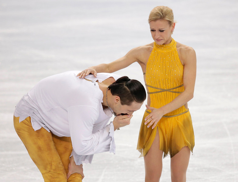 . Tatiana Volosozhar and Maxim Trankov of Russia react after they competed in the pairs free skate figure skating competition at the 2014 Winter Olympics, Wednesday, Feb. 12, 2014, in Sochi, Russia. (AP Photo/Bernat Armangue)