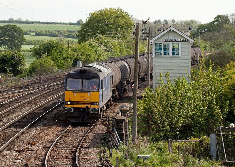 60011 brings the 6D31 09:28 Lindsey-West Burton Powerstation loaded bogie tanks past Barnetby East signal box.